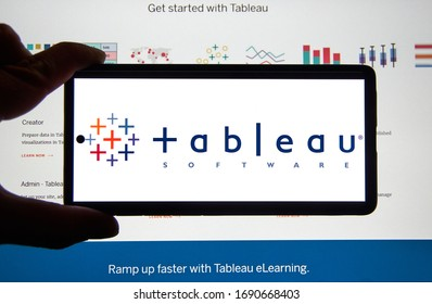 Montreal, Canada - March 08, 2020: Tableau application and logo on android cellphone over a chart. Tableau Software is an American interactive data visualization software company