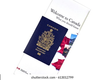 MONTREAL, CANADA - MARCH 10, 2017 : Canadian passport with 'Welcome to Canada' informational brochure from Citizenship and Immigration Canada Ministry