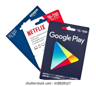 MONTREAL, CANADA - MARCH 10, 2017 : Google Play, Netflix and Amazon popular giftcards. The cards are prepaid stored-value money cards issued to be used as an alternative to cash for purchases.