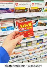 MONTREAL, CANADA - MARCH 10, 2018 : A hand holding Advil pack. Advil ibuprofen is a nonsteroidal anti-inflammatory drug NSAID