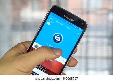 MONTREAL, CANADA - MARCH 20, 2016 - Shazam mobile application on Samsung S5's screen. Shazam is a free application that helps users figure out the name of a catchy song.