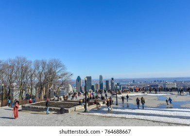 Montreal, Canada - March 20, 2016: People and Montreal Skyline from Kondiaronk Belvedere / Mont-Royal in Winter