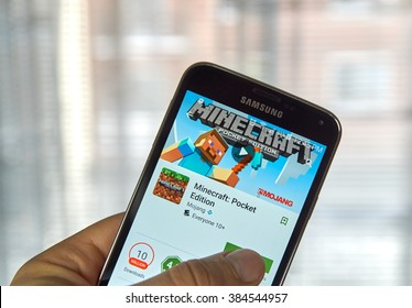 MONTREAL, CANADA - MARCH, 2016 -  Minecraft mobile game on screen of Samsung S5 in a hand. Minecraft is a game where gamer digs mine and builds craft.