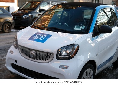 MONTREAL, CANADA - MARCH 23 2019: German car rental company car2go, a subsidiary of Daimler AG, offers Smart and Mercedes-Benz vehicles and features one-way point-to-point rentals.