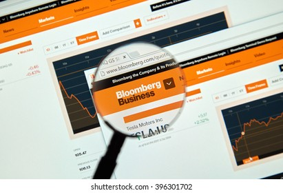 MONTREAL, CANADA - MARCH 25, 2016 - Bloomberg internet page under magnifying glass. Bloomberg is a privately held financial software, data, and media company.