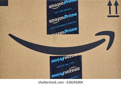 MONTREAL, CANADA - MARCH 28, 2017: Amazon Prime shipping box with branded tape on it. Amazon is an American electronic commerce and cloud computing company.