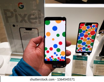 MONTREAL, CANADA - MARCH 28, 2019: Google Pixel 3 phone in a hand at mobile store. Google Pixel is a line of electronic devices developed by Google.