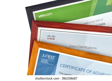 MONTREAL, CANADA - MARCH 3, 2016 - IT certificates Cisco, Juniper and VMware in frames isolated over white.