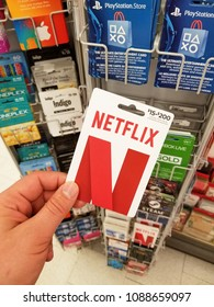MONTREAL, CANADA - MARCH 30, 2018: A hand holding a Netflix gift card. Netflix is a streaming service that allows our customers to watch a wide variety of award-winning TV shows, movies, documentaries