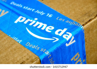 MONTREAL, CANADA - MAY 10, 2019 : Amazon Prime Day cardboard box with Prime Day logo and tape on it. Amazon Prime Day is the retailer's big members-only summer sale in month of July each year.