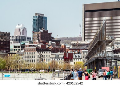 Montreal, Canada - May 12, 2016: Montreal downtown from  Old Port docks with tourists walking around.