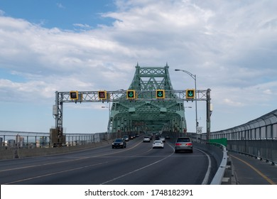 Montreal, Canada - may 2020 : entrance to Jacques Cartier Bridge, a steel truss cantilever bridge crossing the Saint Lawrence River