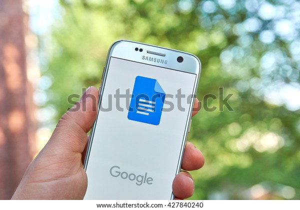MONTREAL, CANADA - MAY 23, 2016 : Google Docs application on Samsung S7 screen. Google Docs is a free Web-based application in which documents and spreadsheets can be created, edited and stored online