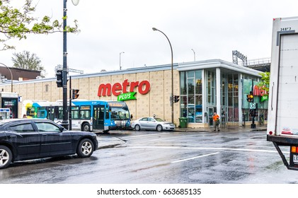 Montreal, Canada - May 26, 2017: Metro Plus grocery store in city in Quebec region during wet rain on cloudy day
