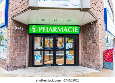 Montreal, Canada - May 26, 2017: Pharmacie store entrance and sign pharmacy in downtown city during daytime