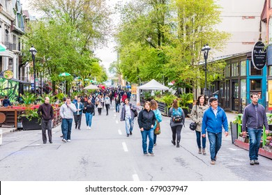 Montreal, Canada - May 26, 2017: People walking on Saint Denis street in Montreal's Plateau Mont Royal in Quebec region