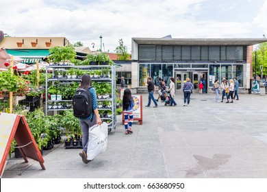 Montreal, Canada - May 27, 2017: People walking by famous shop near metro called Kioske Mont-Royal in Plateau neighborhood during summer during sunny day in city in Quebec region