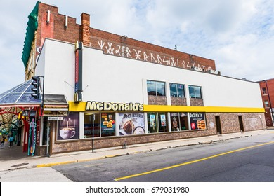 Montreal, Canada - May 27, 2017: McDonalds sign and logo by St Hubert street on Rue Beaubien in Plateau neighborhood in city in Quebec region