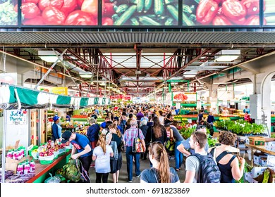 Montreal, Canada - May 28, 2017: Jean Talon market entrance with people inside building buying produce in city in Quebec region