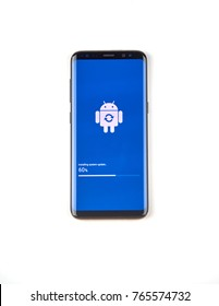 MONTREAL, CANADA - NOVEMBER 12, 2017: Samsung S8 device in process of software update with logo and progress bar on the screen. Samsung Galaxy S8 is one of the most popular cell phones.