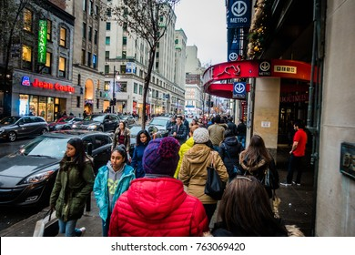 Montreal, Canada - November 25, 2017. People with Walking Fast During Shipping Hour on Ste-Catherine Street before Xmas