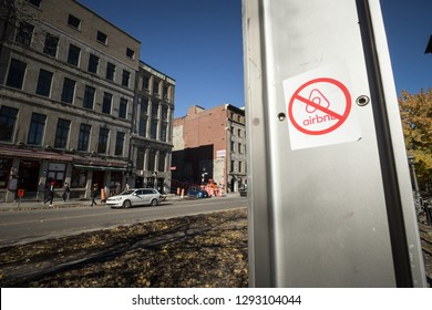 MONTREAL, CANADA - NOVEMBER 3, 2018: Anti Airbnb sticker on the main street of Montreal Port, part of a movement opposing the rental platform and the gentrification of the city