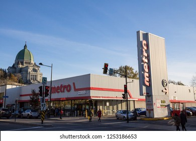 MONTREAL, CANADA - NOVEMBER 4, 2018: Metro logo, in front of their supermarket in northern Montreal, Quebec. Metro Inc. is the 3rd largest Canadian supermarket and grocer chain