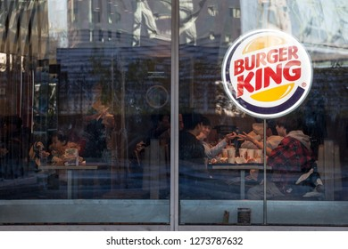 MONTREAL, CANADA - NOVEMBER 4, 2018: Burger King logo on their main fast food restaurant in Montreal, Quebec. Burger King is an american fast food restaurant brand and franchise spread worldwide