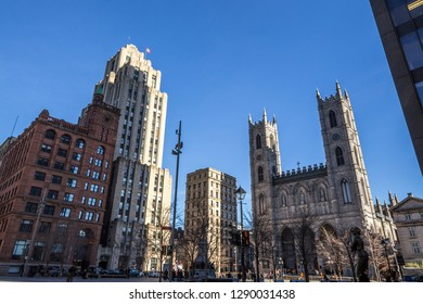 MONTREAL, CANADA - NOVEMBER 4, 2018: Notre Dame Basilica in the Old Montreal and its iconic towers, with the Aldred Building in backgground. The basilica is the main cathedral of Montreal, and a touri