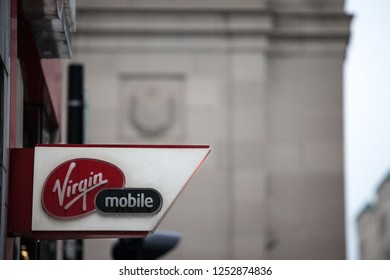 MONTREAL, CANADA - NOVEMBER 5, 2018: Virgin mobile logo on their main shop for Montreal center. Part of Richard Branson Virgin group, it's a telecommuncation and phone carrier