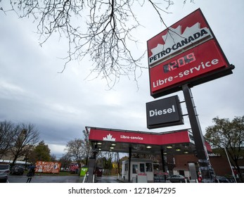 MONTREAL, CANADA - NOVEMBER 6, 2018: Petro-Canada logo in front of one of their gas stations in Canada. Belonging to Suncor Energy, petro Canada is a petrol station brand spread in Canada