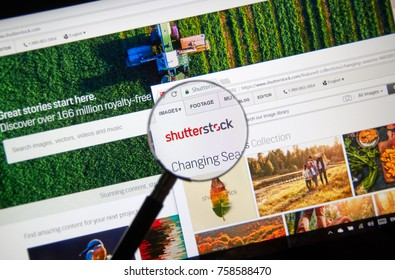 MONTREAL, CANADA - NOVEMBER 7, 2017: Shutterstock homepage and logo under magnifying glass. Shutterstock is an American stock photography, stock footage, stock music provider headquartered in USA