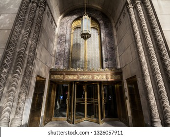 MONTREAL, CANADA - NOVEMBER 7, 2018:  Entrance of the Edifice Dominion Square Building on Sainte Catherine Street with its old revolving doors. It is a monument, a skyscraper of beaux Arts style