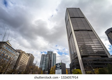 MONTREAL, CANADA - NOVEMBER 7, 2018: Tour de la Bourse skyscraper on the Quartier International District of Montreal, one of the main landmarks and financial centers of Quebec and Canada