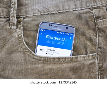 MONTREAL, CANADA - OCTOBER 10, 2017: Wikipedia mobile application on a cellphone screen in a jeans pocket. Wikipedia is a multilingual free encyclopedia based on a model of openly editable content