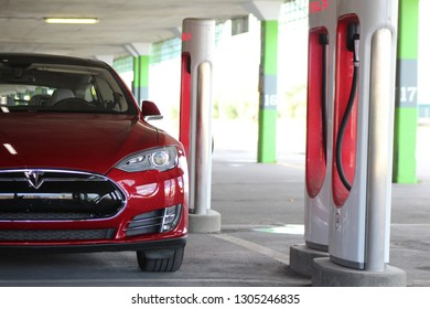 MONTREAL, CANADA - OCTOBER 19, 2018: 2014 Tesla Model S P85 parked at Tesla Supercharger in Montreal, Quebec, Canada on October 19th, 2018.