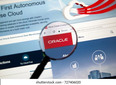 MONTREAL, CANADA - OCTOBER 2, 2017: Oracle home page under magnifying glass. Oracle is one of the largest vendors in the enterprise IT market.