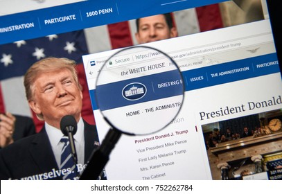MONTREAL, CANADA - OCTOBER 2, 2017: Trump Administration web site under magnifying glass. Donald J. Trump is the 45th President of the United States.