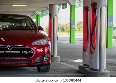 MONTREAL, CANADA - OCTOBER 20, 2018: Tesla Model S parked at Tesla Supercharger in Montreal, Ontario, Canada on October 20th, 2018.