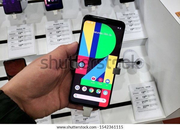 Montreal, Canada - October 26, 2019: Google Pixel 4 XL phone in a hand at mobile store. Google Pixel smartphone is a line of cellphones devices developed by Google and running Android operating system