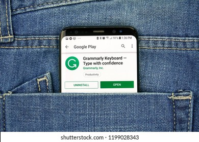 MONTREAL, CANADA - OCTOBER 4, 2018: Grammarly grammar check Android mobile app on s8 screen in a jeans pocket. Grammarly is an English-language writing-enhancement software developed by Grammarly Inc
