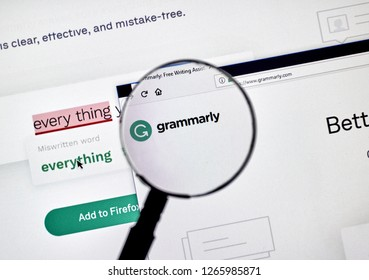 MONTREAL, CANADA - OCTOBER 4, 2018: Grammarly check web page on a PC screen under magnifying glass. Grammarly is a popular English-language writing-enhancement software developed by Grammarly Inc