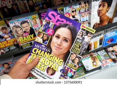 MONTREAL, CANADA - OCTOBER 9, 2018: Star Magazine in a hand over a stack of magazines with Meghan Markle on front cover. Star is a popular American celebrity tabloid magazine