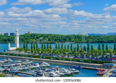 Montreal, Canada - September 08, 2018: View of the old port, with the clock tower, the Biosphere, locals and visitors, in Montreal, Quebec, Canada