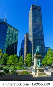 Montreal, Canada - September 08, 2018: View of downtown, near Dorchester Square, with locals, in Montreal, Quebec, Canada