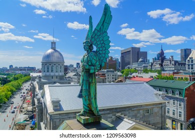 Montreal, Canada - September 08, 2018: View of an Angel statue (Notre-Dame-de-Bon-Secours Chapel), the old town, with locals and visitors, in Montreal, Quebec, Canada