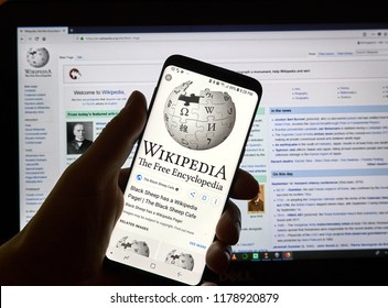 MONTREAL, CANADA - SEPTEMBER 13, 2018: A hand holding a Samsung S8 smartphone with Wikipedia app. Wikipedia is a multilingual, web-based, free encyclopedia based on a model of openly editable content