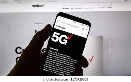 MONTREAL, CANADA - SEPTEMBER 13, 2018: A hand holding a cellphone with opened Verizon 5g official web page. Verizon Wireless is an American telecommunications company which offers wireless products