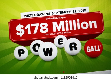 MONTREAL, CANADA - SEPTEMBER 23, 2018: Powerball official site and logo on a laptop screen. Powerball is a popular American lottery game offered by 44 states in USA