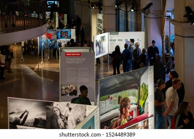 MONTREAL, CANADA - September 28, 2017:  People visiting the World Press Photo exhibition in Montreal on September 28, 2017.